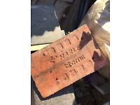 Red concrete roof tiles
