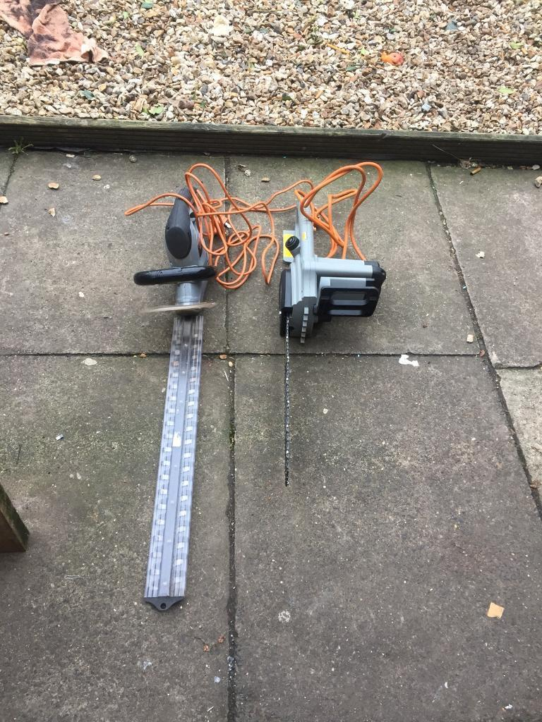 Titan electric chainsaw and hedge strimmer