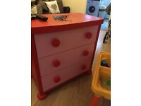 Pink and red ikea chest of drawers