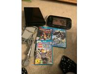 Black Nintendo Wii U console with games