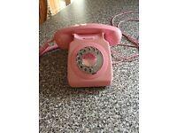 Retro 1970 style pink telephone