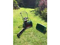 Qualcast 43s classic petrol mower with scarifying attachment