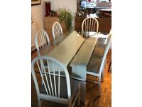 Glass dining table and 6 wooden matching chairs