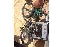 "Grey and green mountain bike. 18"" wheels"