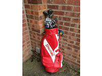 Golf clubs - drivers and irons - plus putter Spalding bag , wheels