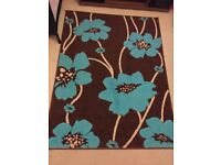 Teal, brown and cream rug