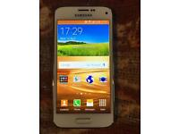 Samsung Galaxy S5 mini, unlocked, white, grade A. Like new.