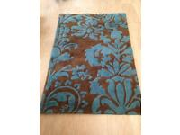 Gorgeous turquoise rug & matching cushions. Cost £400 new £75