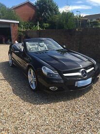 2012 Mercedes SL AMG professionally modified in 2014 and is Mint throughout and must be seen
