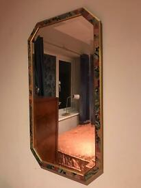 Wall mirror with oval floral frame