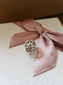 Genuine Pandora open Primrose charm