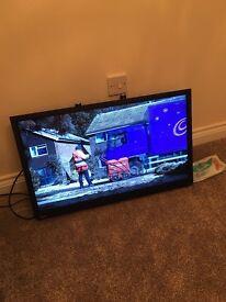 "x2 32"" television built in dvd + brackets"
