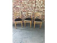 Three mid century kitchen chairs