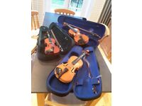 2 violins, believed to be, 1 quarter and 1 half.