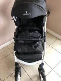 Venicci pram with carry cot , rain covers, adaptors ,changing bag