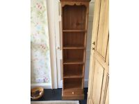 Pine tall thin bookcase with drawer