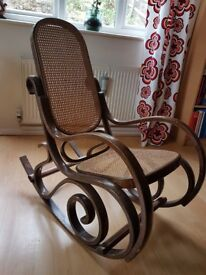 Beautiful wooden and rattan rocking chair