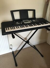 Yamaha keyboard. Comes with music stand and stand.