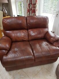 Brown leather 2x 2 seater sofas and an armchair