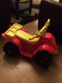 Electric ride-on toy quad