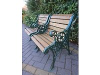 A MATCHING PAIR OF SOLID CAST IRON CHAIRS IN METALLIC GREEN FOR GARDEN, PATIO