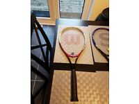 1 wilson tennis raquet and 1 slazenger tennis raquet with tennis balls