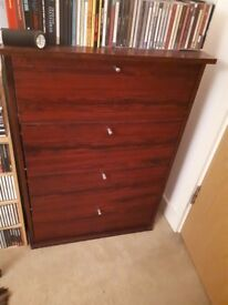 Mahogany effect CD storage unit.