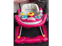 Baby walker and rocker 2 in one with music 🎶 in very good condition from smoke and pets free home
