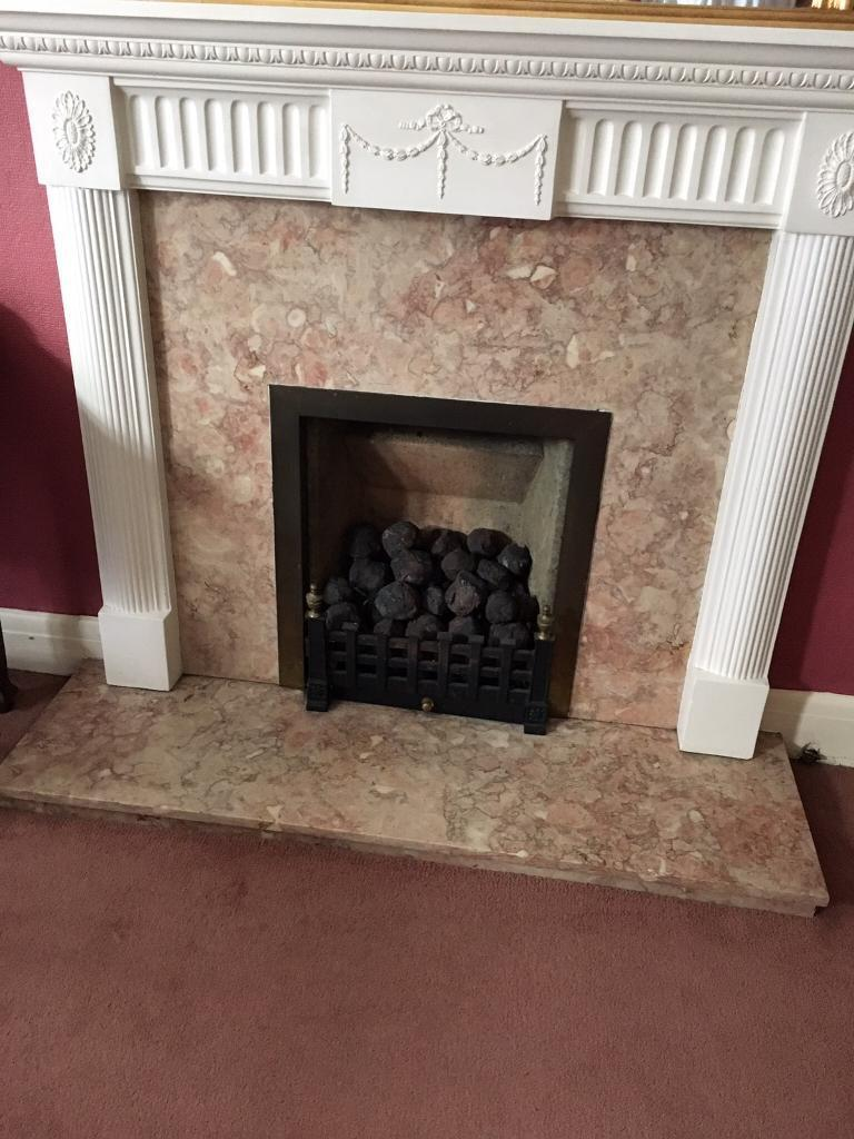 marble fire surround and hearth with white fire mantle piece