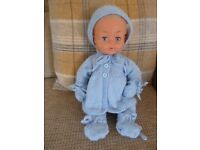 Hand knitted baby doll outfit