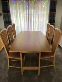 'Habitat' large dining room table and 6 'Sterling furniture' chairs.