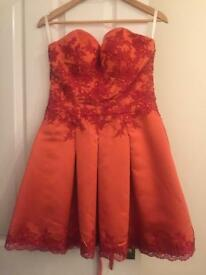 Lovely dress size 8, bloody orange colour