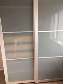 "IKEA Wardrobe 6'6"" x 5'x2'' frosted doors. Good condition"