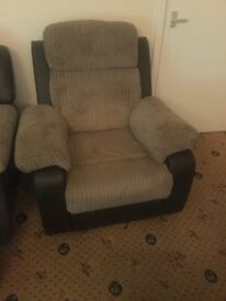 Brown fabric and faux leather recliner chair