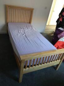 Solid single oak bed