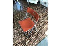 Orange folding chair