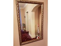 LARGE ANTIQUE LOOKING GOLD WALL MIRROR WITH WIDE DECORATIVE FRAME - heavy piece
