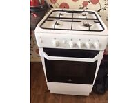 Free standing white gas cooker.