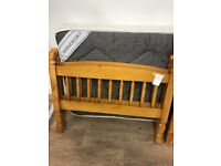 Pine bed frame with single mattress