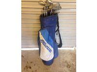 Set of golf clubs and Mizuno lightweight golf bag.
