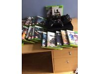 Xbox 360 with 3 controllers and 27 games