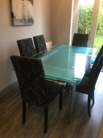 Extendable glass dining table and 6 damask chairs