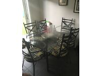 Glass dining table and 6 cast iron chairs