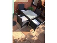 4 Rattan black garden chairs/cushions and table