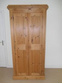 Solid pine hanging wardrobe, with bottom shelf. Excellent condition. H 198cm, W 90cm, D 56cm.