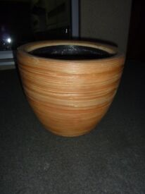 Bamboo wrapped ceramic plant pot.