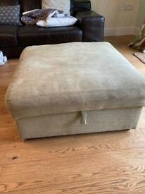 Green footstool and storage.