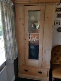 Pine wardrobe and matching dresser.