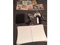 Nintendo Wi with 7 games, 3 controllers and wi fit board