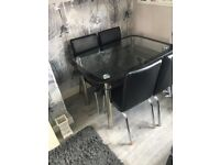 Dining table and black leather chairs